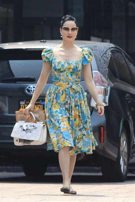 dita von teese leaves cafe gratitude  los angeles