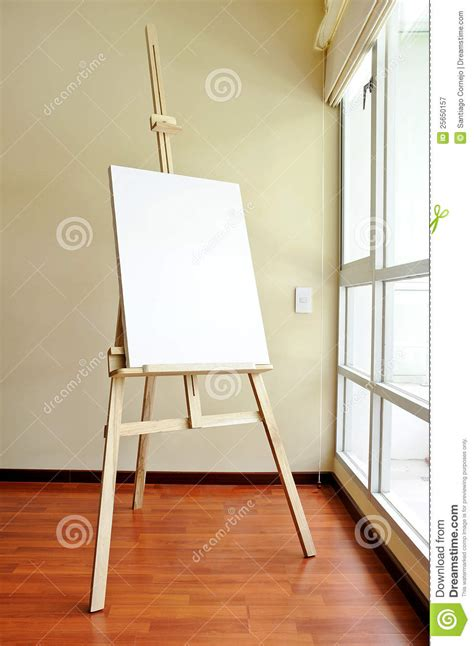 blank canvas   wooden tripod   studio royalty