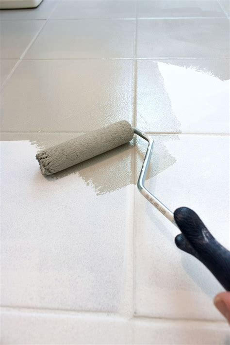 how i painted our bathroom 39 s ceramic tile floors a simple and cheap diy driven by decor