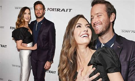 Armie Hammer can't keep his hands off wife at LA screening ...