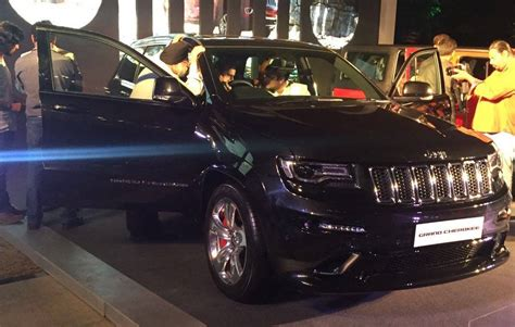 open jeep modified in black colour jeep showcases wrangler grand cherokee srt in india