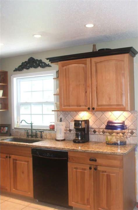 black kitchen cabinet crown molding note light rail