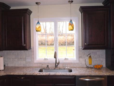 over bathroom sink lighting double pendant lights over sink traditional kitchen