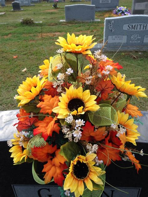 fall cemetery vase using sunflowers mixed leaves filler flowers with lime green shiny