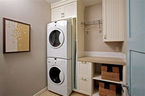washer dryer stacked basement laundry room design remodel and makeover ideas