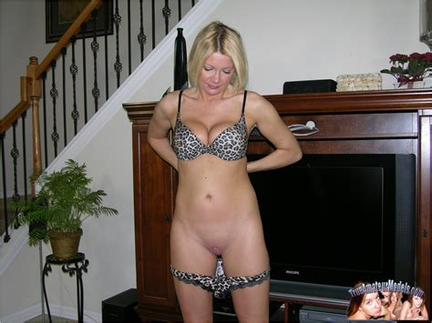 smiling blonde haired amateur with smoothly shaved pussy and juicy boobs strips naked