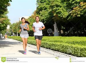 Running Couple Runners Jogging In City Park Stock Photo ...