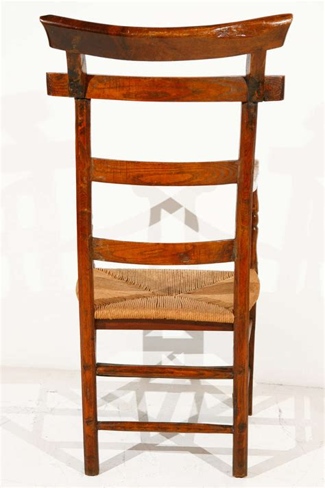 ladder back oak and elm chair with rush seat at 1stdibs