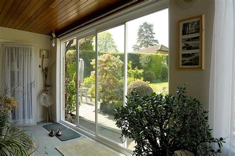 sliding patio doors or frameless bifolding doors fgc