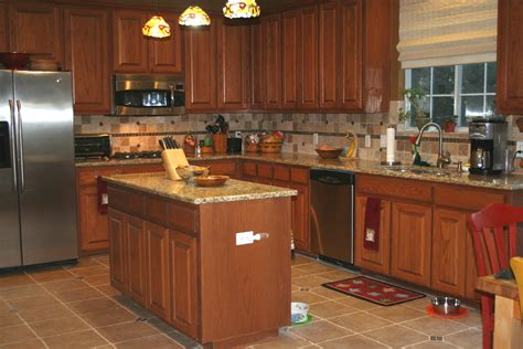 kitchen cabinet tops back splash designs for kitchen with beige and brown granite counter tops with oak cabinets