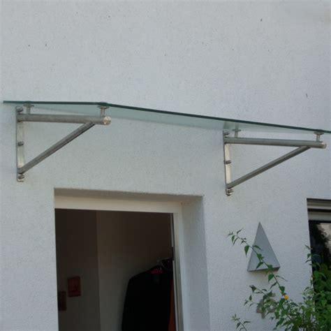 vordach glas edelstahl haust 252 rvordach aus glas mit runden vordachhaltern aus