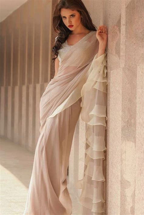 youdesign georgette ruffle saree  cream colour