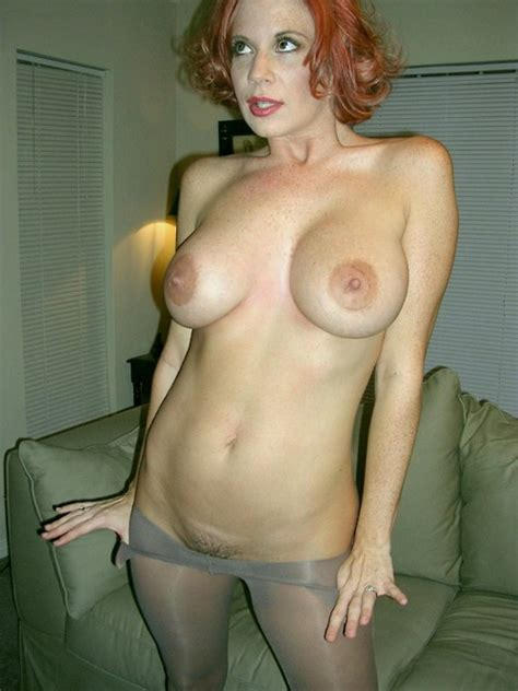 Busty Redhead Milf Strips Out Of Her Pantyhose Milf