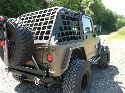 find  lifted armored jeep tj   miles