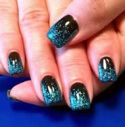 Black base gel with custom blue glitter fade nail design