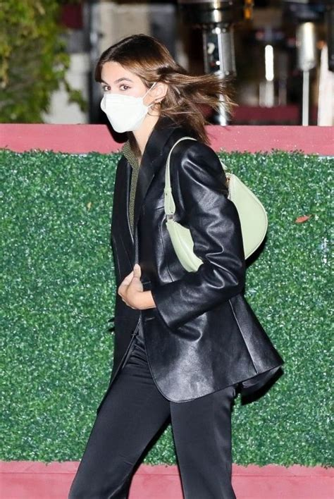 Kaia Gerber Looks stylish in a leather jacket and black ...