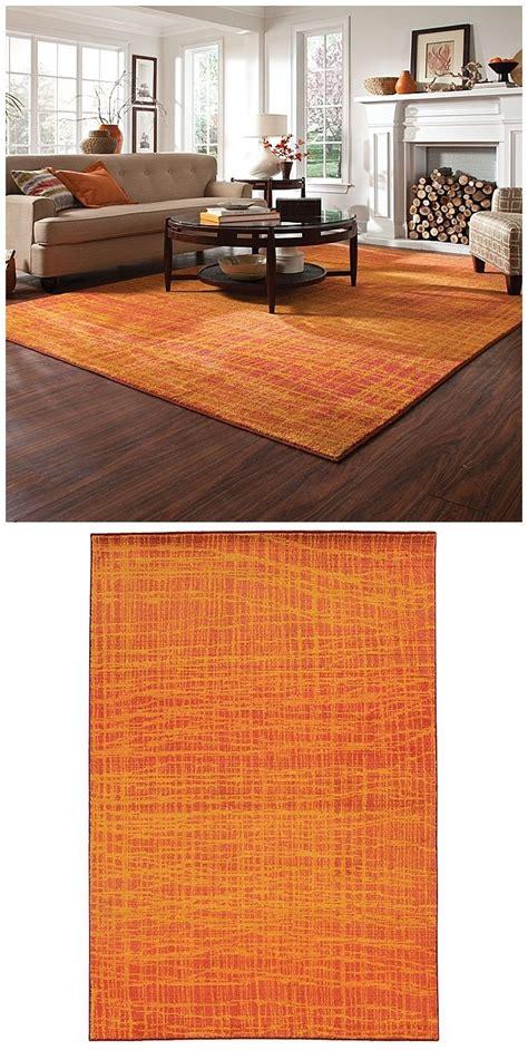 beautiful burnt orange rug creates  striking statement
