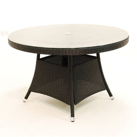 rattan table and chairs in three sizes by out there