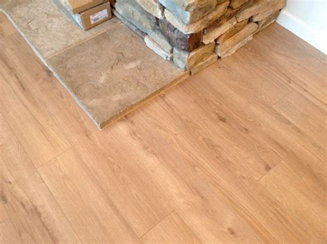 laminate wood flooring around fireplace laminate 21 21 laminate plank flooring install as a floating floor around rock fireplace in a
