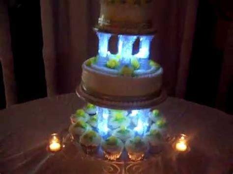 wedding cake  room dimmed showing cake lit candles
