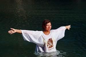 Christian Pilgrims Baptised In The River Jordan - Zimbio