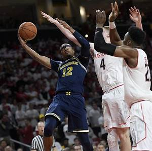 A bespectacled Abdur-Rahkman leads Michigan in blowout win ...