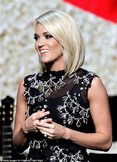 Carrie Underwood wears mini dress to celebrity fight night