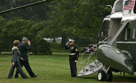 president george  bush salutes     laura bush
