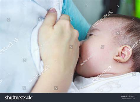 Closeup Portrait Mother Breastfeeding Her Newborn Stock