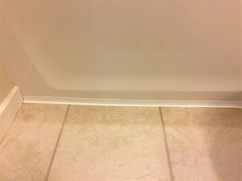 Installing Caulk Strip Over Cracked Grout  Checking In
