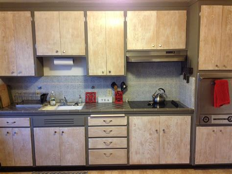 how to refinish wood kitchen cabinets refinished hickory wood kitchen cabinets with gray stained 8859
