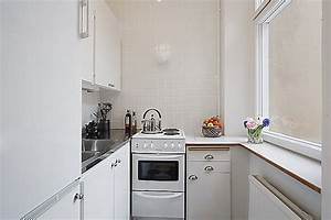 Clean white small apartment interior design with for Interior decoration for very small kitchen