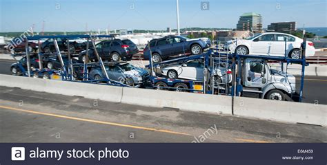 car carrier tractor trailer with new subaru cars on i 95