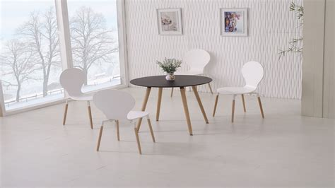 white wood round dining table round wooden black dining table and 4 white chairs