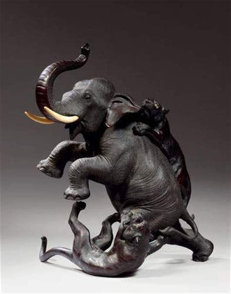 tibet alain r truong japon groupe en bronze à patine brune éléphant attaqué