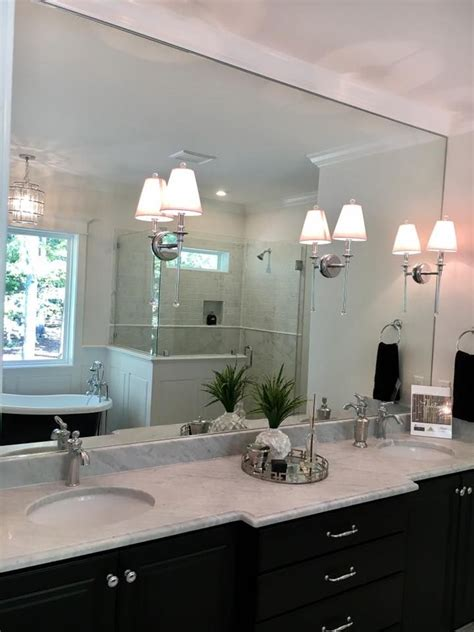 chrome sconces mounted  bathroom mirror bathroom