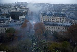 Fresh violence in Paris as riot police use tear gas and ...