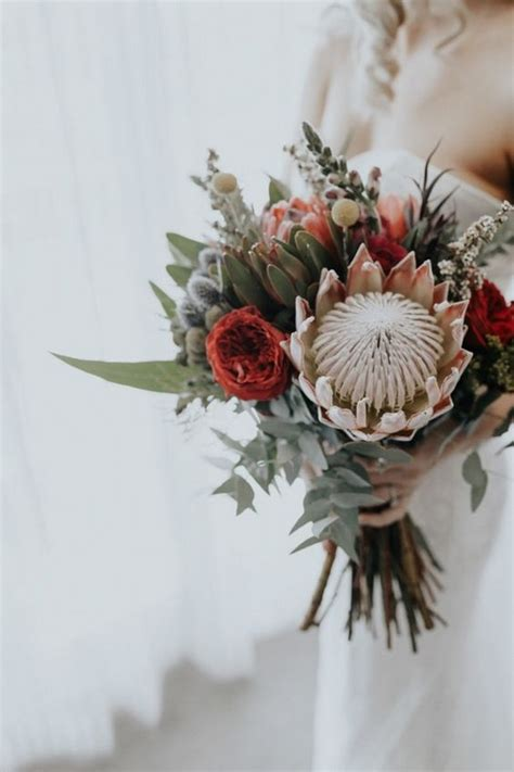 wedding flower trends   protea wedding bouquets