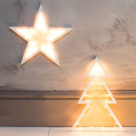 xmas tree or star light up decorations by the forest co