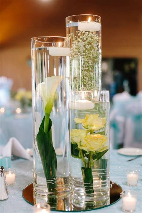 submerged flowers for wedding center pieces not too