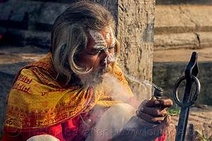 baba smoking a chillum of bhang, ritual cannabis
