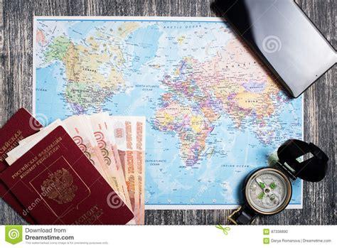 Passport Money Compass And Camera On Map Stock Photo