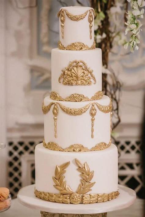 white and gold cake gold wedding white gold wedding cakes 2097280 weddbook 1294