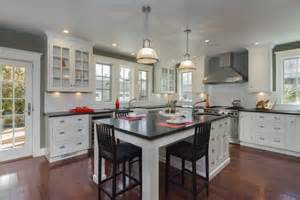 white kitchen island with black granite top a beautiful white kitchen can provide a timeless stylish look
