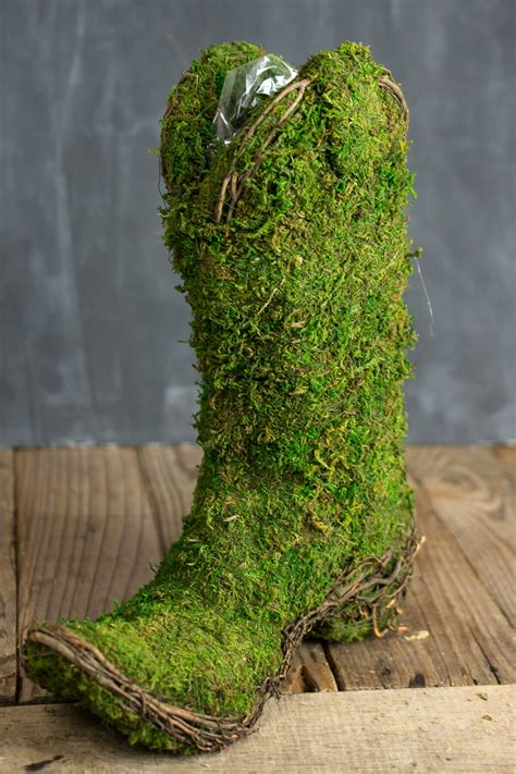 moss covered cowboy boot topiary pot