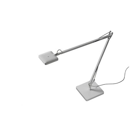 This lamp provides direct light and features a swiveling head. Flos Kelvin LED GM Table Lamp