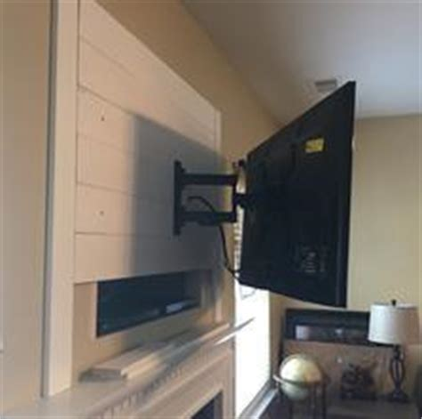 mounting flat screen tv covering  fireplace niche