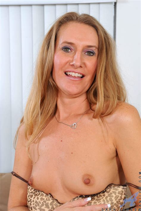 Erotic mature Sara James strips off her lingerie and ...