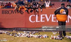 bottles and debris litter the field at cleveland browns
