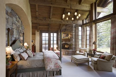 Stone Wall. Mountain Lodge. Wood Ceiling. Master Bedroom. Custom Bedding. Designed By Locati